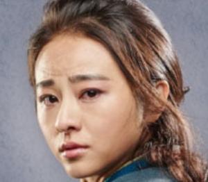 ナン・ジー/萱素(けんそ)役